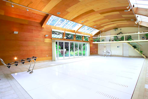 Concert Hall Moving Floor Pool: modern Pool by London Swimming Pool Company