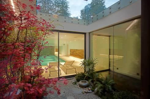 Minimalist Subterranean Pool: modern Pool by London Swimming Pool Company