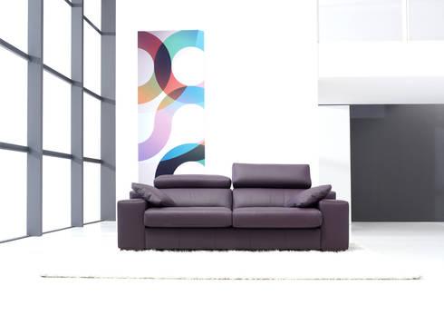 Una colorida temporada en Casasola Muebles: Salones de estilo moderno de Casasola Decor