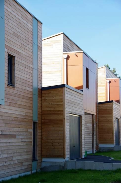 Casas de estilo  por 2424 ARQUITECTURA