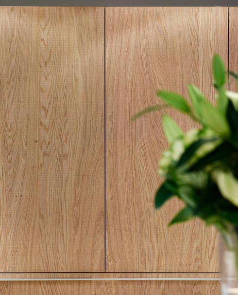 bulthaup Rough Sawn Oak Pocket door:   by hobsons choice