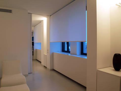 LOFT – BERGAMO: Case in stile in stile Minimalista di SERGIO PASCOLO ARCHITECTS