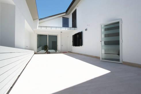 Casa L_01: Case in stile in stile Moderno di Gimmigi Lab Architettura