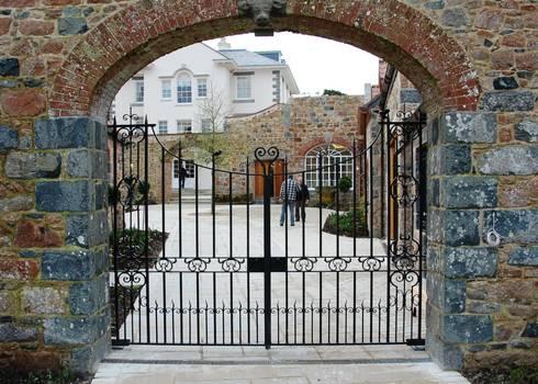 Courtyard gates:   by Unique Iron Design Ltd.