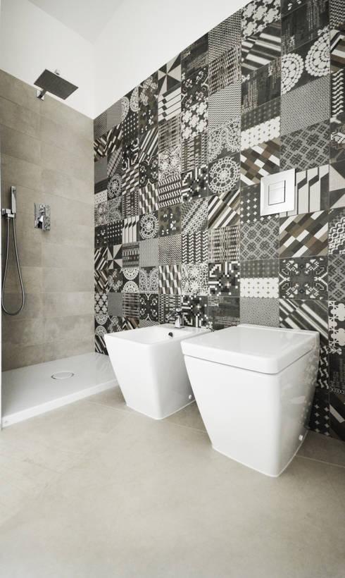 Casas de banho ecléticas por fds|officina di architettura