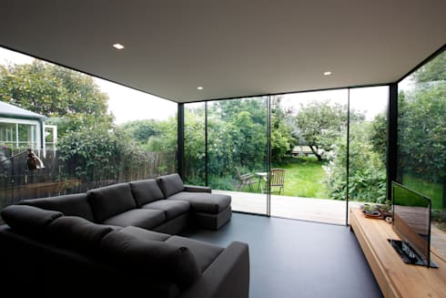 Turney Road: modern Living room by IQ Glass UK