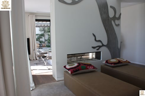 CHIMENEA PANORAMICA ESPECIAL: Salones de estilo moderno de CHIMENEASAML