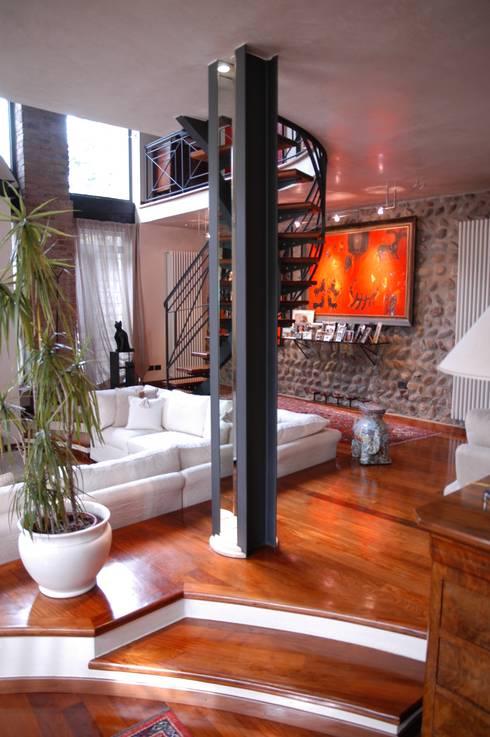 Casas de estilo ecléctico por Paolo Gerosa Design Studio