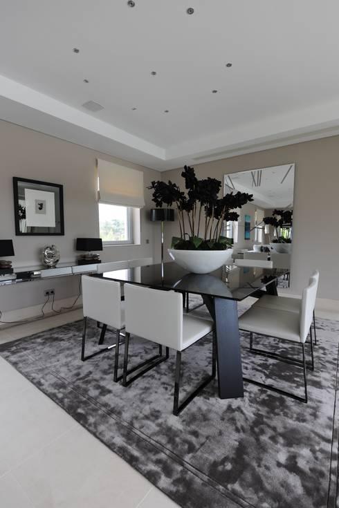 Quinta do Lago: modern Dining room by Cheryl Tarbuck Design