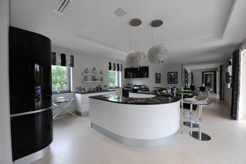 Quinta do Lago: modern Kitchen by Cheryl Tarbuck Design