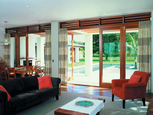 CoFold Sliding Folding Door Hardware: tropical Living room by Coastal Joinery Hardware