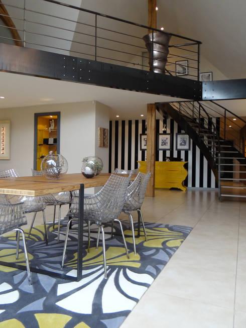 Dining room by UN AMOUR DE MAISON