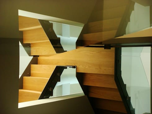 Staircases:   by Studiodare Architects