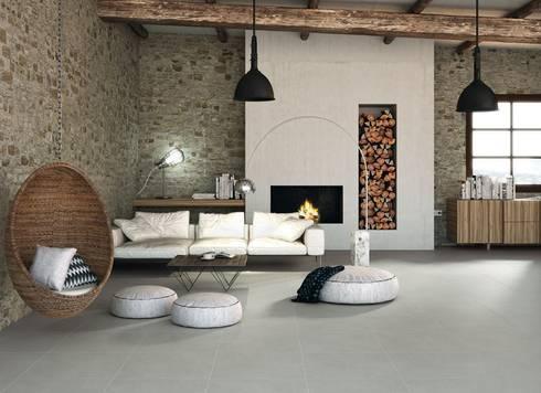 Salón contemporáneo con pavimento de inspiración cemento.: Paredes y suelos de estilo moderno de Porcelanite Dos