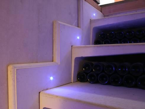 Illuminated Staircase: modern Wine cellar by Stone Cellar Company