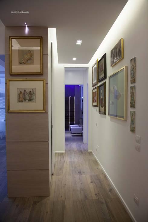corridoio: Ingresso & Corridoio in stile  di G/G associati studio di ingegneria e architettura _ing.r.guglielmi_arch.a.grossi