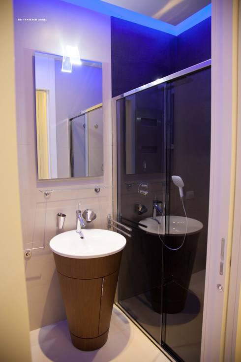 bagno: Bagno in stile  di G/G associati studio di ingegneria e architettura _ing.r.guglielmi_arch.a.grossi