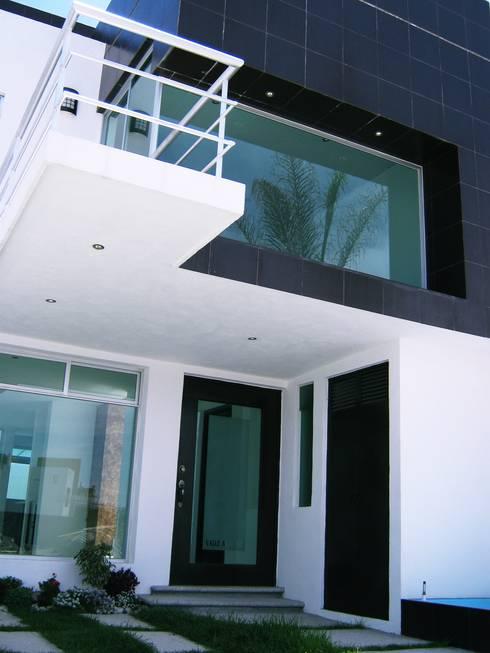 Casa LV: Casas de estilo minimalista por ipalma arquitectos