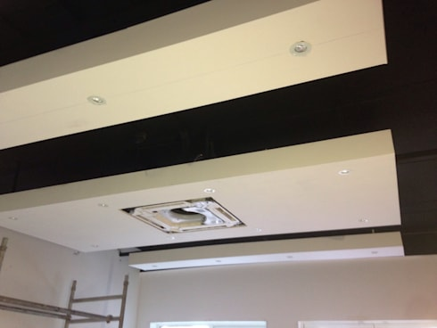 Meeting room with 'floating ceiling' rafts:  Office buildings by Lancashire design ceilings