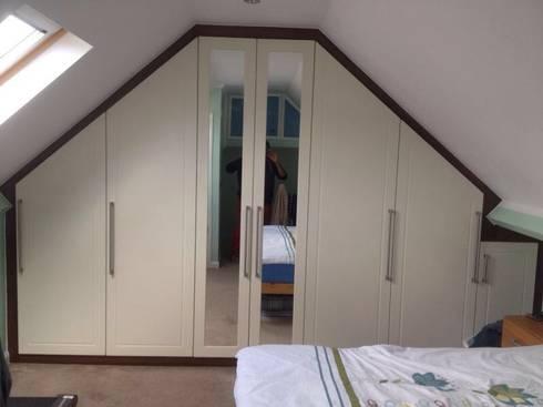 Loft wardrobes : modern Bedroom by Smiths fitted wardrobes Ltd