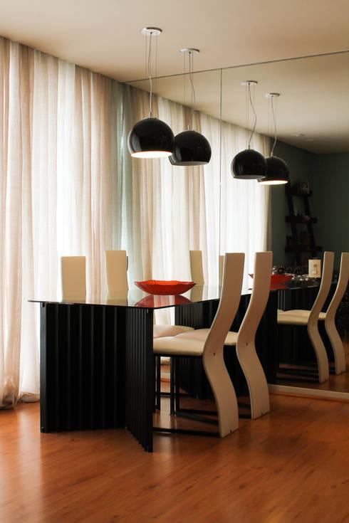 Sala de jantar: Salas de jantar modernas por Dobra I Oficina de Arquitetura