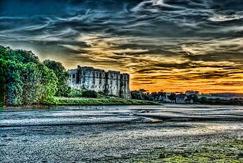 Carew Castle Pembrokeshire At Sunset: eclectic Corridor, hallway & stairs by Steve Purnell