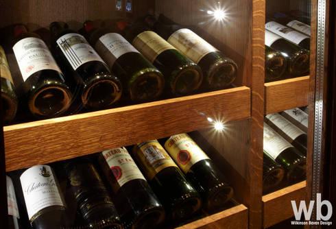 Private Wine & Cigar Room: eclectic Wine cellar by Wilkinson Beven Design