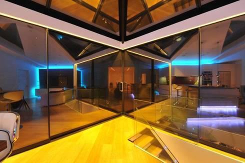 Semi-detached glory hole: modern Conservatory by Paul Wiggins Architects