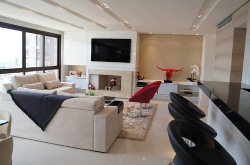 Área Social Integrada: Salas de estar modernas por Triple Arquitetura