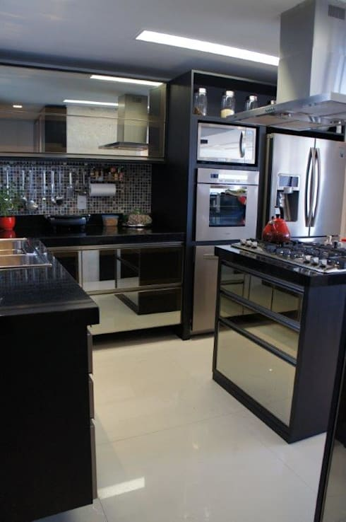 Cozinha gourmet: Cozinhas modernas por Triple Arquitetura