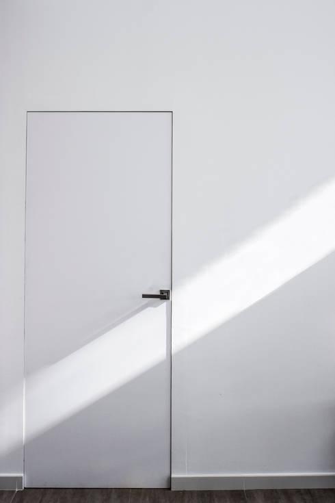 Casas de estilo minimalista por RUBÉN MUEDRA ESTUDIO DE ARQUITECTURA