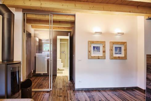 L'ingresso: Ingresso & Corridoio in stile  di STUDIO PAOLA FAVRETTO SAGL - INTERIOR DESIGNER