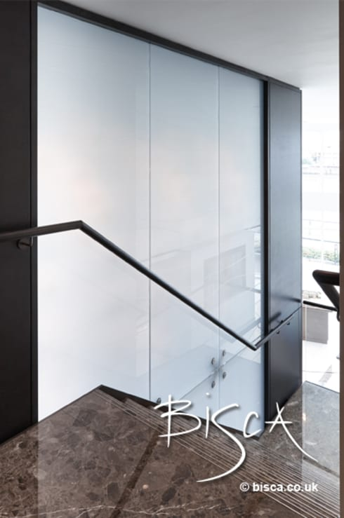 Timber Handrail on Stone Staircase:  Corridor, hallway & stairs by Bisca Staircases
