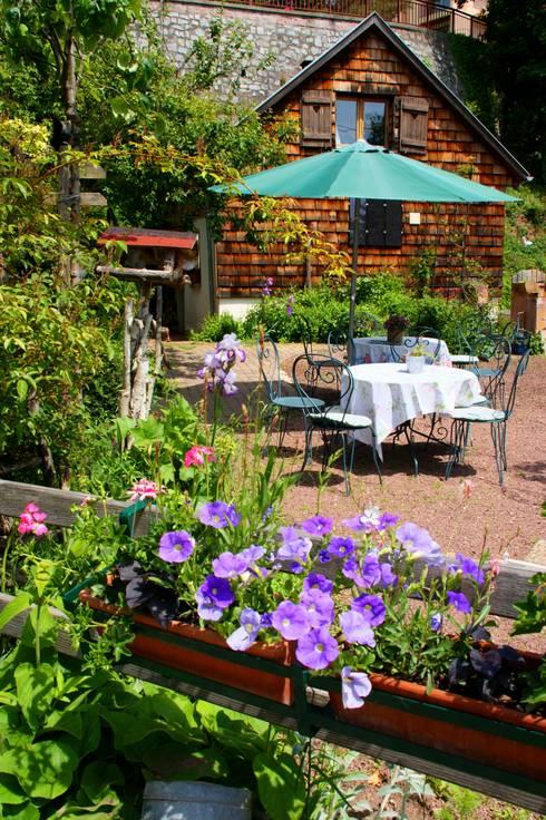 Hotel Villa Rosa: Jardin de style  par villa rosa