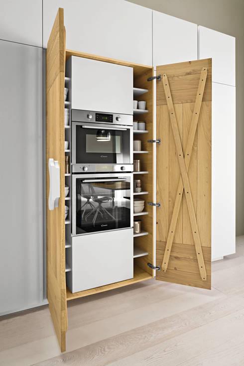 eclectic Kitchen by ARREX LE CUCINE