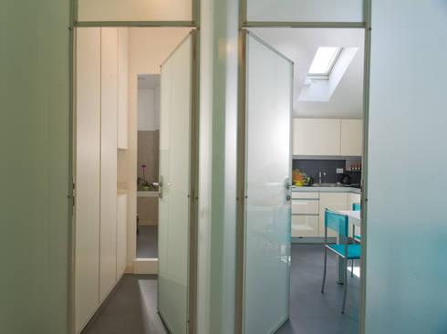 Appartamento a Milano in Porta Romana:  in stile  di ARCHITETTO MARCO TAGLIAPIETRA