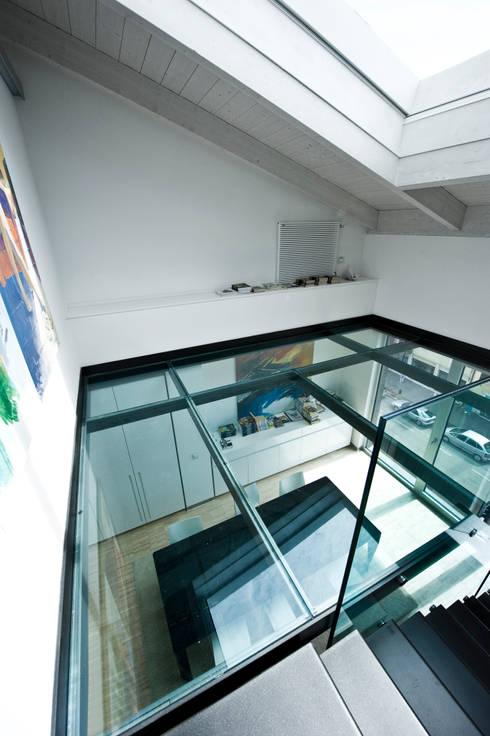 Casas de estilo  de Studio Merlini Architectural Concept
