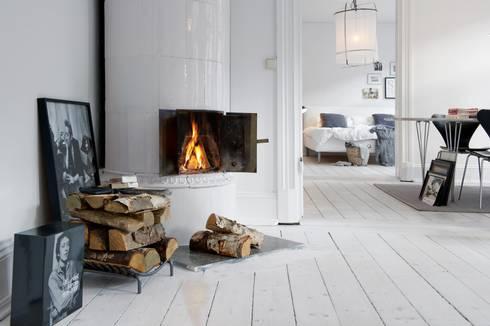 Alvhem Mäkleri & Interiör - cover photo: scandinavian Living room by Magdalena Kosidlo