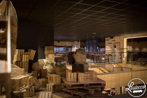 LOSTECCO : Spazi commerciali in stile  di Andrea Langhi Design