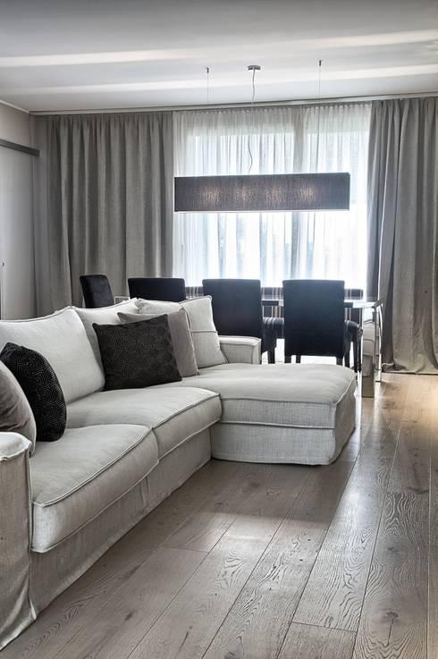 Il soggiorno: Soggiorno in stile in stile Moderno di STUDIO PAOLA FAVRETTO SAGL - INTERIOR DESIGNER