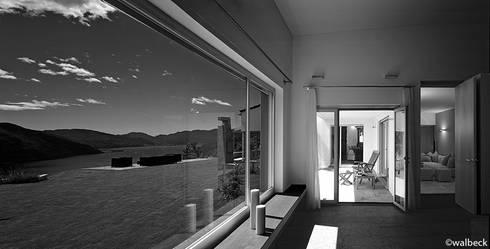 Casa Bill:  in stile  di Buzzi studio d'architettura