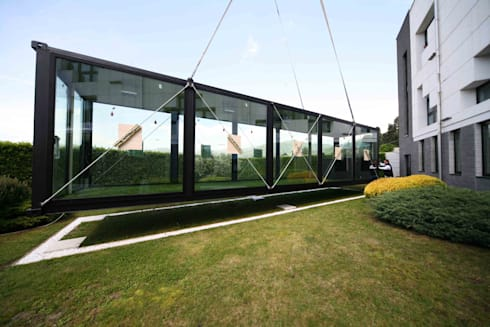 Greentainer:  in stile  di Exposure Architects
