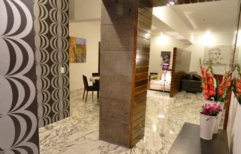 PHM 05: Pasillos y recibidores de estilo  por NIVEL TRES ARQUITECTURA