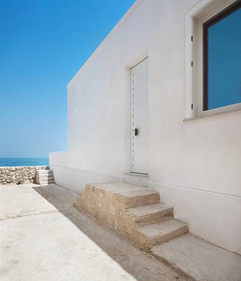 Casa EC: Finestre in stile  di Indice Creativo