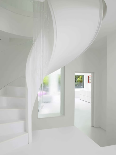 Ice White House-Luxury home:  Corridor & hallway by Quirke McNamara