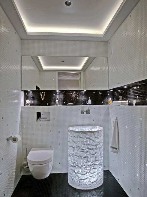 Baños de estilo  por UTH living stone GmbH
