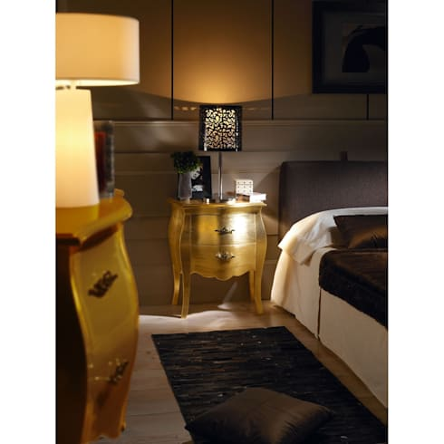 Aurum de Dissery: Dormitorios de estilo moderno de Ociohogar