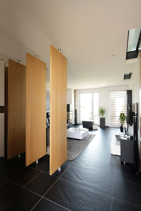 Casas de estilo  por in_design architektur