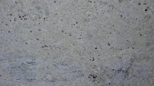 Granito Blanco Romano: Paredes y pisos de estilo clásico por Marmoles Continentales