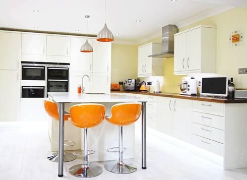 Sleek modern kitchen, Norfolk:  Kitchen by Rebecca Coulby Interiors